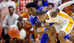 Tennessee guard Lamonte Turner (1) battles for the loose ball with Memphis guard Jayden Hardaway (25) during the first half of an NCAA college basketball game Saturday, Dec. 14, 2019, in Knoxville, Tenn. (AP Photo/Wade Payne)