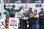 Justin Haley, left, celebrates in Victory Lane with crew members after winning the NASCAR Xfinity Series auto race at Daytona International Speedway, Saturday, Aug. 28, 2021, in Daytona Beach, Fla. (AP Photo/John Raoux)