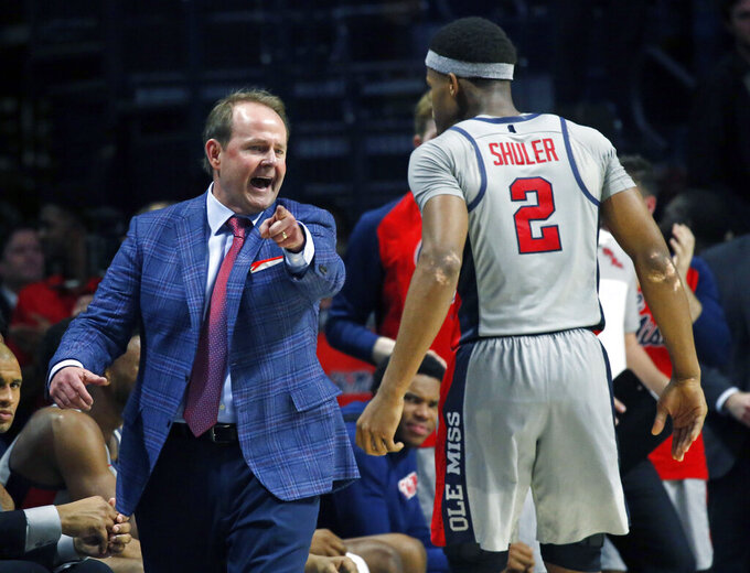 In this Jan. 9, 2019, photo, Mississippi coach Kermit Davis directs guard Devontae Shuler (2) in a NCAA college basketball game against Auburn in Oxford, Miss. The coaching comeback of Davis is a tale three decades in the making and as Mississippi's first-year coach has the Rebels back in the AP Top 25 for the first time since 2013. (AP Photo/Rogelio V. Solis)