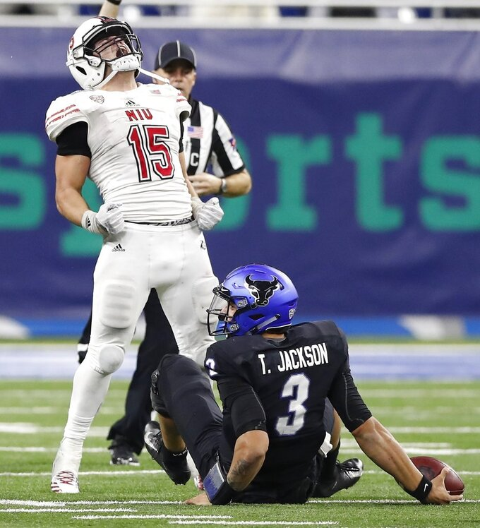 Northern Illinois defensive end Sutton Smith (15) reacts after sacking Buffalo quarterback Tyree Jackson (3) during the second half of the Mid-American Conference championship NCAA college football game, Friday, Nov. 30, 2018, in Detroit. (AP Photo/Carlos Osorio)