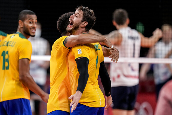 Brazil's Bruno Mossa Rezende celebrates his team victory against United States during a men's volleyball preliminary round pool B match between Brazil and United States at the 2020 Summer Olympics, Friday, July 30, 2021, in Tokyo, Japan. (AP Photo/Manu Fernandez)