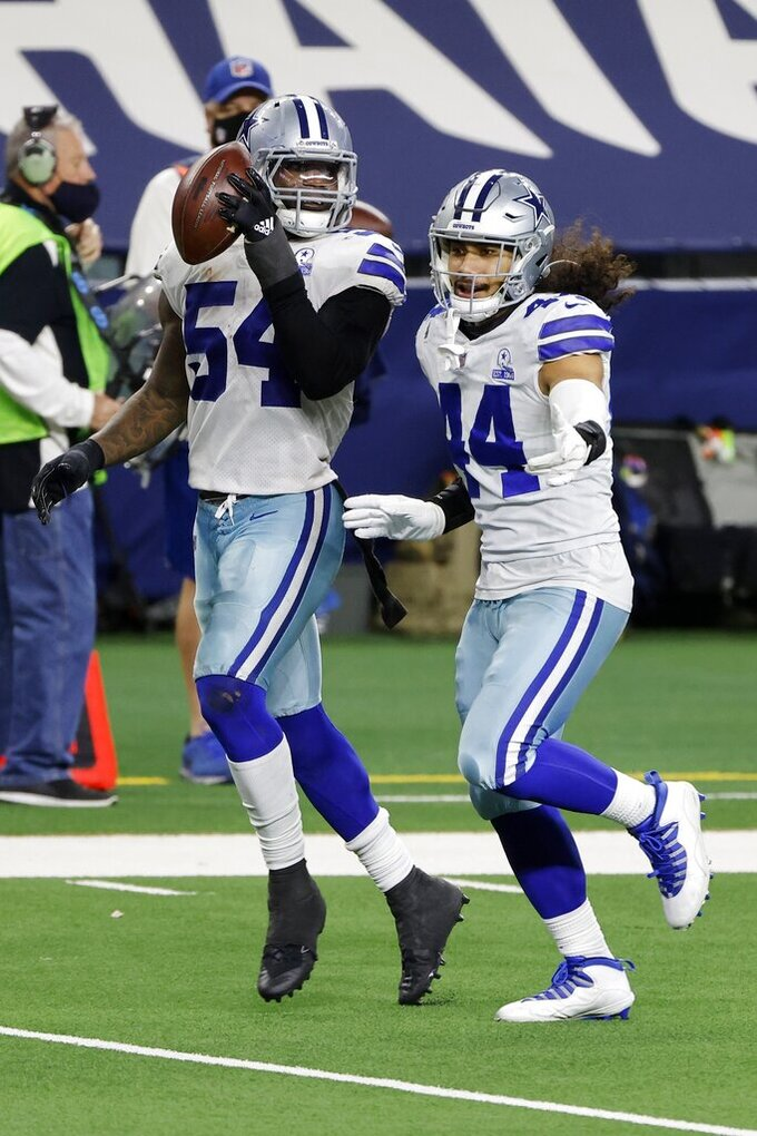 Dallas Cowboys linebacker Jaylon Smith (54) and linebacker Francis Bernard (44) celebrate after the Cowboys recovered a Philadelphia Eagles quarterback Jalen Hurts (2) fumble in the second half of an NFL football game in Arlington, Texas, Sunday, Dec. 27. 2020. (AP Photo/Michael Ainsworth)