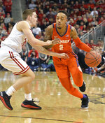 Clemson guard Marcquise Reed (2) attempts to drive past the defense of Louisville guard Ryan McMahon (30) during the first half of an NCAA college basketball game in Louisville, Ky., Saturday, Feb. 16, 2019. (AP Photo/Timothy D. Easley)