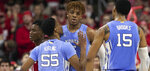 North Carolina's Christian Keeling (55) chest bumps teammate Armando Bacot (5) after a Bacot dunk against North Carolina State during the first half of an NCAA college basketball game at PNC Arena in Raleigh, N.C., Monday, Jan. 27, 2020. (Robert Willett/The News & Observer via AP)