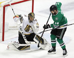 Vegas Golden Knights goaltender Marc-Andre Fleury (29) deflects a shot with his glove under pressure from Dallas Stars left wing Jamie Benn (14) in the third period of an NHL hockey game in Dallas, Friday, March 15, 2019. The Golden Knights won 2-1. (AP Photo/Tony Gutierrez)