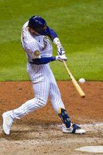 Milwaukee Brewers' Ryan Braunhits a game-winning sacrifice fly during the ninth inning of a baseball game against the Chicago Cubs Friday, Sept. 11, 2020, in Milwaukee. The Brewers won 1-0. (AP Photo/Morry Gash)