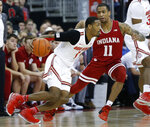 Ohio State's Luther Muhammad, left, drives to the basket as Indiana's Devonte Green defends during the first half of an NCAA college basketball game Saturday, Feb. 1, 2020, in Columbus, Ohio. (AP Photo/Jay LaPrete)