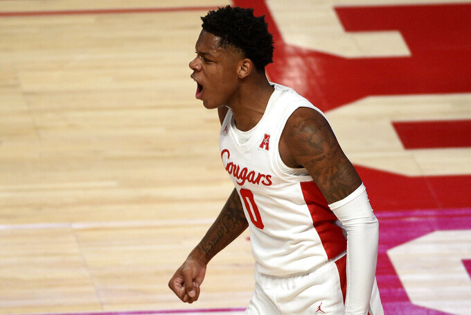 Houston guard Marcus Sasser (0) reacts after drawing a foul during the first half of an NCAA college basketball game against Tulane, Saturday, Jan. 9, 2021, in Houston. (AP Photo/Eric Christian Smith)