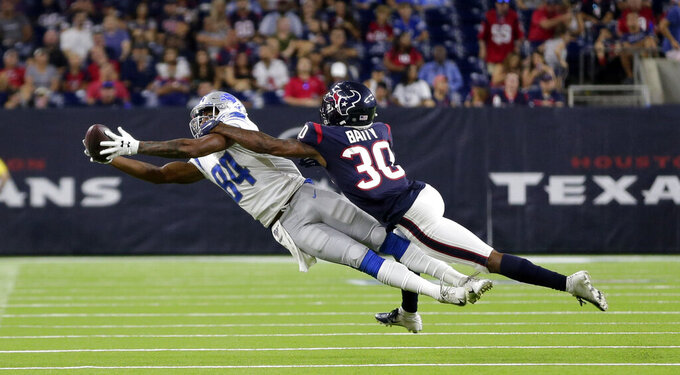 Detroit Lions wide receiver Travis Fulgham (84) catches a pass as Houston Texans defensive back Derrick Baity (30) defends during the second half of an NFL preseason football game Saturday, Aug. 17, 2019, in Houston. (AP Photo/Michael Wyke)