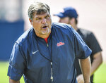 Mississippi head coach Matt Luke works with the offensive lineman during NCAA college football practice in Oxford, Miss., Monday, Aug. 5, 2019. (Bruce Newman/Oxford Eagle via AP)
