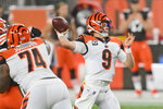 Cincinnati Bengals quarterback Joe Burrow throws a 23-yard touchdown pass to tight end C.J. Uzomah during the first half of an NFL football game against the Cleveland Browns, Thursday, Sept. 17, 2020, in Cleveland. The touchdown pass was the first one of Burrow's career.  (AP Photo/David Richard)