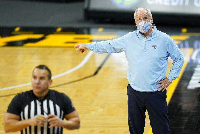 North Carolina head coach Roy Williams reacts to a call against his team during the second half of an NCAA college basketball game against Iowa, Tuesday, Dec. 8, 2020, in Iowa City, Iowa. Iowa won 93-80. (AP Photo/Charlie Neibergall)