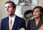 Kentucky Attorney General Andy Beshear, left, answers questions from after announcing his campaign for governor on Monday, July 9, 2018, in Louisville, Ky. Beshear says he will seek the Democratic nomination for governor in 2019. His running mate Jacqueline Coleman, an assistant principal at Nelson County High School and former basketball coach, listens at right. (AP Photo/Adam Beam)