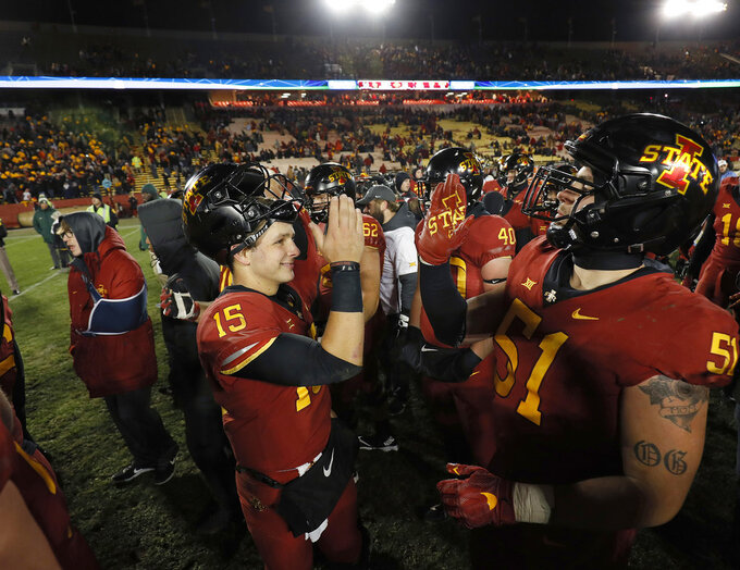 Iowa State quarterback Brock Purdy, left, celebrates a win over Baylor with offensive lineman Julian Good-Jones after an NCAA college football game, Saturday, Nov. 10, 2018, in Ames, Iowa. (AP Photo/Matthew Putney)