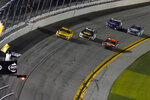 Michael McDowell, left, wins the NASCAR Daytona 500 auto race at Daytona International Speedway, Monday, Feb. 15, 2021, in Daytona Beach, Fla. (AP Photo/Chris O'Meara)