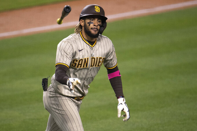 San Diego Padres' Fernando Tatis Jr. tosses his bat after hitting a solo home run during the sixth inning of the team's baseball game against the Los Angeles Dodgers in Los Angeles, Saturday, April 24, 2021. (AP Photo/Kyusung Gong)