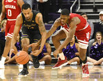 Northwestern guard Ryan Taylor, left, and Indiana guard Aljami Durham, right, go for a loose ball during the first half of an NCAA college basketball game Tuesday, Jan. 22, 2019, in Evanston, Ill. (AP Photo/David Banks)