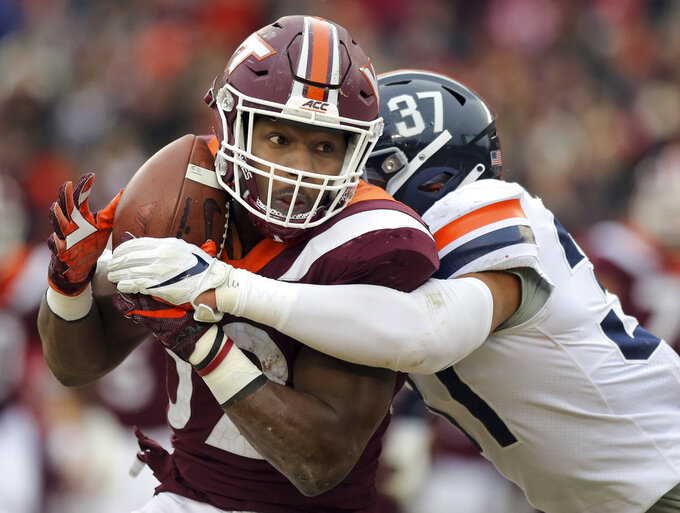 Virginia Tech running back Steven Peoples (32) has a pass knocked away from him by Virginia defender Nasir Peoples (31) during the first half of an NCAA college football game in Blacksburg, Va., Friday, Nov. 23, 2018. (Matt Gentry/The Roanoke Times via AP)