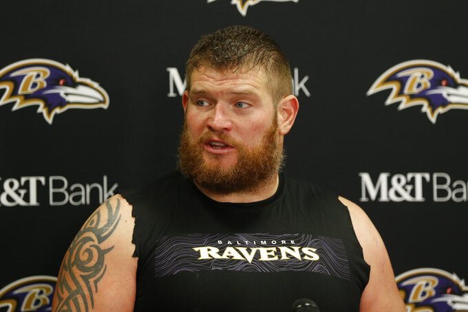 FILE - This is a Dec. 22, 2019, file photo showing Baltimore Ravens offensive guard Marshal Yanda answering questions at a news conference after the Ravens defeated the Cleveland Browns in an NFL football game in Cleveland. Yanda is retiring after 13 seasons in which he was named to the Pro Bowl eight times and helped Baltimore win the 2012 Super Bowl.(AP Photo/Ron Schwane, File)