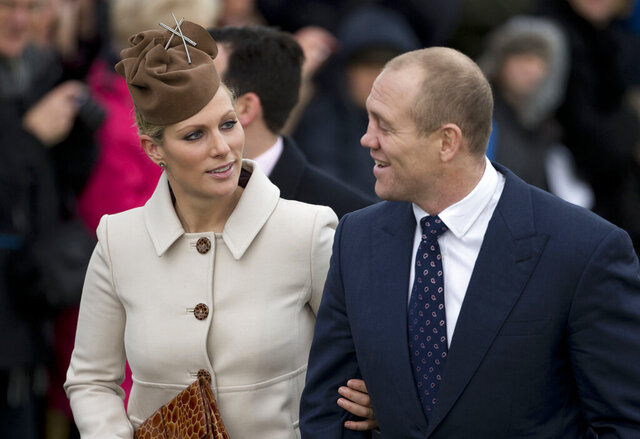 """FILE - In this file photo dated Tuesday, Dec. 25, 2012, showing the granddaughter of Britain's Queen Elizabeth II, Zara Phillips and her husband Mike Tindall as they arrive for the British royal family's traditional Christmas Day church service in Sandringham, England.  Zara and Mike Tindall are pregnant with her third child and a Buckingham Palace spokesman said Wednesday Dec. 9, 2020, that the queen and her husband Philip are """"delighted"""" by the news.(AP Photo/Matt Dunham, File)"""