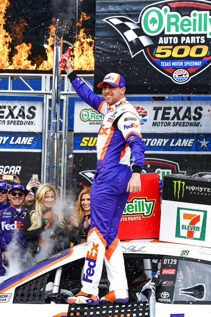 Denny Hamlin celebrates in Victory Lane after winning a NASCAR Cup auto race at Texas Motor Speedway, Sunday, March 31, 2019, in Fort Worth, Texas. (AP Photo/Larry Papke)