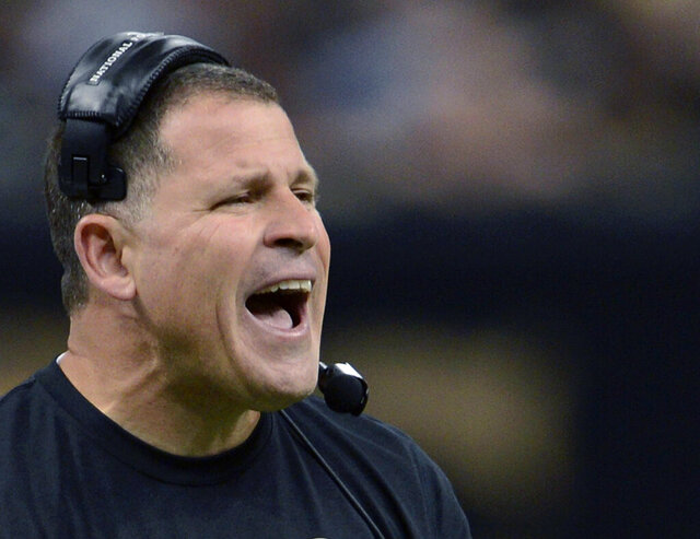FILE - In this Dec. 29, 2013, file photo, then-Tampa Bay Buccaneers head coach Greg Schiano reacts on the sideline in the first half of an NFL football game against the New Orleans Saints in New Orleans. Greg Schiano is coming back to Rutgers. Athletic director Pat Hobbs announced Sunday, Dec. 1, 2019 the university and Schiano have reached a contract agreement, a week after talks to bring back the 53-year-old former Scarlet Knights head coach fell apart. (AP Photo/Bill Feig, File)