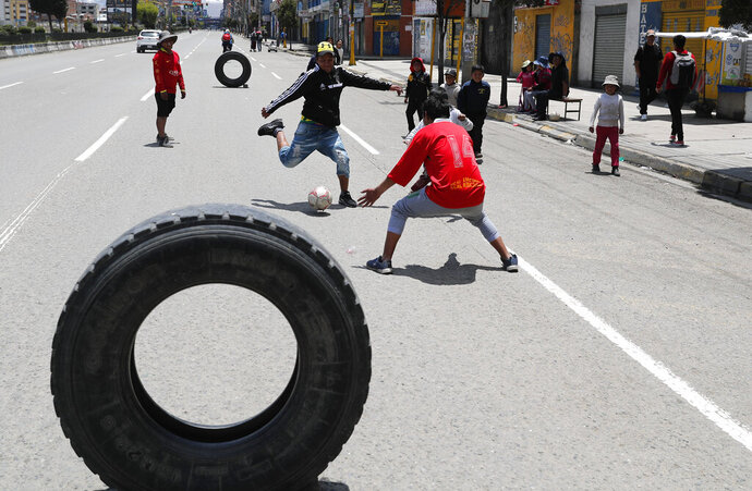 Children play soccer in El Alto, outskirts of La Paz, Bolivia, Sunday, Oct. 20, 2019. Bolivians are voting in general elections Sunday where President Evo Morales is candidate for a fourth term. (AP Photo/Jorge Saenz)