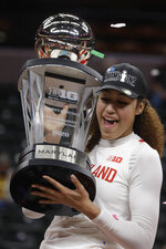 Maryland's Shakira Austin holds the trophy after her team defeated Ohio State to win the NCAA college basketball championship game at the Big Ten Conference tournament, Sunday, March 8, 2020, in Indianapolis. (AP Photo/Darron Cummings)