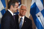 Vice President Mike Pence, right, and Greek Prime Minister Kyriakos Mitsotakis appear at a reception, hosted by Secretary of State Mike Pompeo, at the State Department in Washington, Wednesday, Jan. 8, 2020. (AP Photo/Cliff Owen)