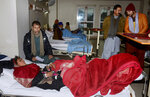 A girl who was injured in an avalanche, is treated at a hospital in Muzaffarabad, the capital of Pakistan-administered Kashmir, Wednesday, Jan. 15, 2020. Search teams aided by Pakistani troops pulled out 21 more bodies from homes destroyed by this week's avalanches in the disputed Himalayan region of Kashmir, raising the overall death toll due to severe winter weather to more than 155 for Pakistan and Afghanistan, officials said. (AP Photo/M.D. Mughal)