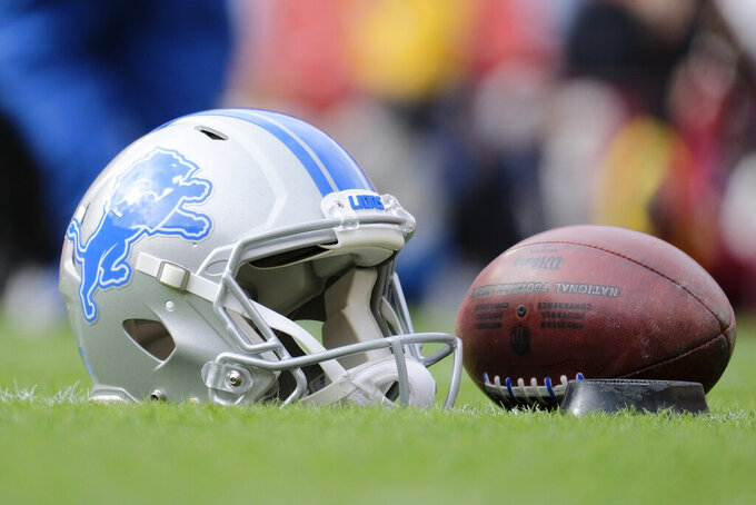 FILE - In this Nov. 24, 2019, file photo, a Detroit Lions helmet sits on the field prior to an NFL football game between the Lions and Washington Redskins in Landover, Md. No piece of protective equipment has undergone as much transformation over the past decade as the helmet. Through a combination of technological advancements, investment by the NFL and an open marketplace for development, helmets are rapidly evolving _ with more innovation on the horizon. (AP Photo/Mark Tenally, File)