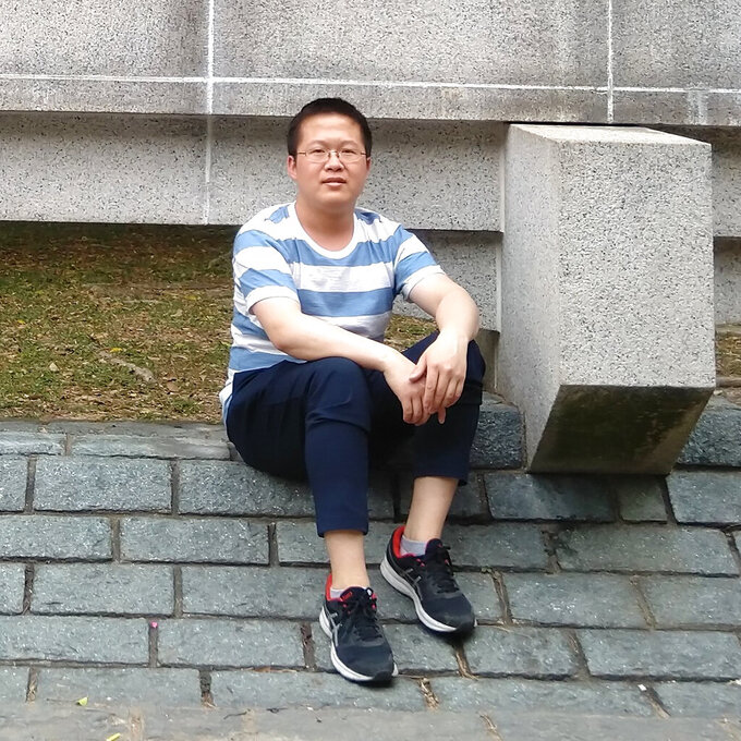In this photo released by Chen Mei Family, Chen Mei poses for a photo in Hong Kong in 2018. More than a year after two young men, including Chen Mei, disappeared from their Beijing homes, they are set to be tried Tuesday, May 11, 2021 in a case that illustrates the Chinese government's growing online censorship and sensitivity to any criticism of its COVID-19 response. (Chen Mei Family via AP)