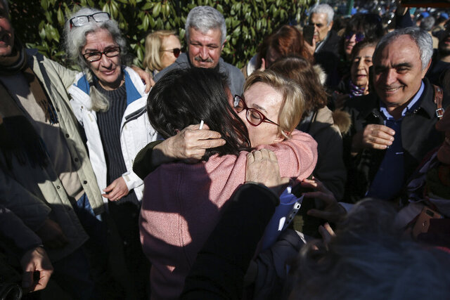 Mucella Yapici, one of defendants, celebrates after a court acquitted nine leading Turkish civil society activists of terrorism-related charges related to anti-government protests, including an entrepreneur known for philanthropy who has been jailed for more than two years, in Silivri, outside Istanbul, Tuesday, Feb. 18, 2020. (AP Photo/Emrah Gurel)