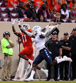 Virginia Tech's Tré Turner (11) catches a pass past the defense of North Carolina's Kyler McMichael (1) during the first half of an NCAA college football game Friday, Sept. 3, 2021, in Blacksburg, Va. (Matt Gentry/The Roanoke Times via AP)