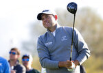 FILE - In this Feb. 2, 2018, file photo, Bill Haas watches his ball from the third tee box during the second round of the Waste Management Phoenix Open golf tournament in Scottsdale, Ariz. Haas has been released from hospital after being a passenger in a car crash which left one person dead and two injured, police in Los Angeles have said. The crash involved a Ferrari and a BMW in the Pacific Palisades neighbourhood at 6.31pm on Tuesday evening , Feb. 13, 2018, according to the Los Angeles Police Department. A car that the LAPD said belonged to the actor Luke Wilson was hit by the Ferrari just before the crash. (Patrick Breen/The Arizona Republic via AP, File)/The Arizona Republic via AP)