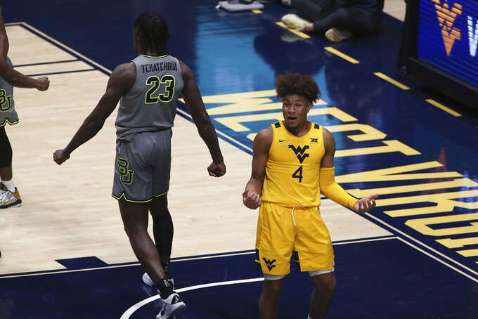 West Virginia guard Miles McBride (4) reacts to a call against him during overtime of the team's NCAA college basketball game against Baylor on Tuesday, March 2, 2021, in Morgantown, W.Va. (AP Photo/Kathleen Batten)