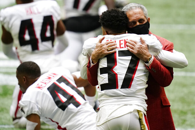 Atlanta Falcons Owner embraces Atlanta Falcons free safety Ricardo Allen (37) before the first half of an NFL football game between the Atlanta Falcons and the Denver Broncos, Sunday, Nov. 8, 2020, in Atlanta. (AP Photo/Brynn Anderson)