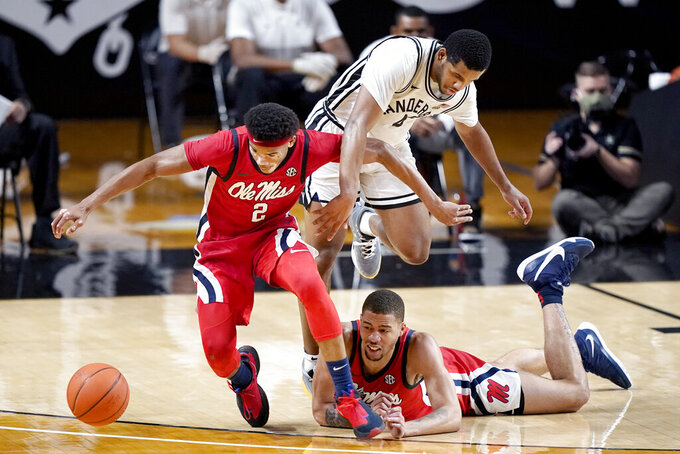 Mississippi's Devontae Shuler (2) and KJ Buffen, right, chase a loose ball with Vanderbilt's Jordan Wright (4) in the first half of an NCAA college basketball game Saturday, Feb. 27, 2021, in Nashville, Tenn. (AP Photo/Mark Humphrey)