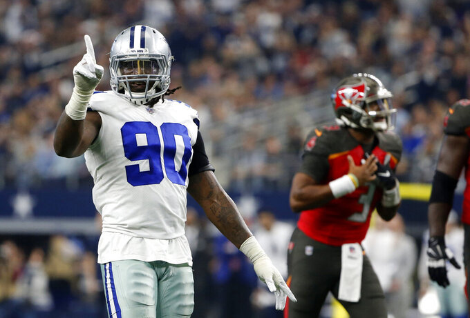 FILE - In this Dec. 23, 2018, file photo, Dallas Cowboys defensive end DeMarcus Lawrence (90) celebrates as Tampa Bay Buccaneers quarterback Jameis Winston shouts in the direction of an official after throwing an incomplete pass during the second half of an NFL football game in Arlington, Texas. A person with direct knowledge of the deal says the Cowboys have agreed on a $105 million, five-year contract with Lawrence. The agreement will include $65 million in guaranteed money, the person told The Associated Press on condition of anonymity Friday, April 5, because the deal hasn't been announced. (AP Photo/Michael Ainsworth, File)