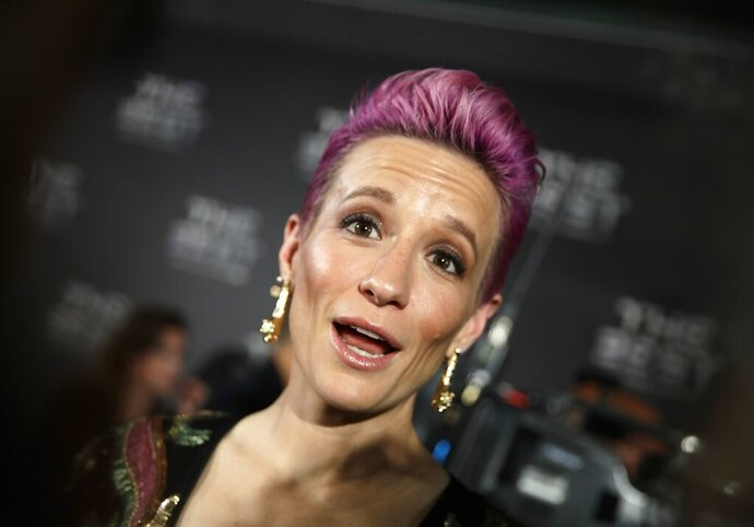 United States forward Megan Rapinoe arrives to attend the Best FIFA soccer awards, in Milan's La Scala theater, northern Italy, Monday, Sept. 23, 2019. Netherlands defender Virgil van Dijk is up against five-time winners Cristiano Ronaldo and Lionel Messi for the FIFA best player award and Rapinoe is the favorite for the women's award. (AP Photo/Luca Bruno)