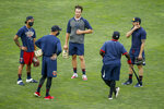 Minnesota Twins manager Rocco Baldelli, second from left, speaks with Eddie Rosario, Max Kepler, Tommy Watkins, and Jake Cave, left to right, at baseball camp Monday, July 6, 2020, in Minneapolis. (AP Photo/Bruce Kluckhohn)