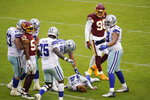 Dallas Cowboys quarterback Andy Dalton (14) lies on the ground after getting hit by Washington Football Team inside linebacker Jon Bostic (53) in the second half of an NFL football game, Sunday, Oct. 25, 2020, in Landover, Md. (AP Photo/Patrick Semansky)