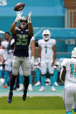Seattle Seahawks cornerback Ryan Neal (35) intercepts a pass, during the first half of an NFL football game against the Miami Dolphins, Sunday, Oct. 4, 2020 in Miami Gardens, Fla. (AP Photo/Wilfredo Lee)