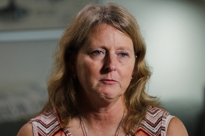 Debbi Hixon, cries as she speaks during an interview with The Associated Press on Friday, Feb. 14, 2020, in Hollywood, Fla. Hixon is the widow of Chris Hixon who was killed in a school shooting on Valentine's Day two years ago at Marjory Stoneman Douglas High School. She recently had the family home renovated by the program