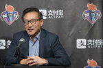FILE - In this May 9, 2019, file photo, Joe Tsai, co-founder and executive vice chairman of Alibaba Group and the new owner of the New York Liberty, speaks to reporters during a news conference before a WNBA exhibition basketball game between the Liberty and China in New York. The Liberty will have a new home next year, playing their games at Barclays Center. The building was recently purchased by Liberty owner Tsai, who also owns the Brooklyn Nets. Playing in Barclays Center is a huge upgrade for the Liberty, who played the past two seasons at the Westchester County Center, where the capacity was set for just over 2,000 fans. (AP Photo/Mary Altaffer, File)