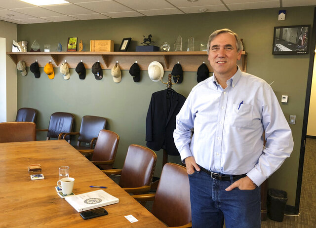 FILE - In this Sept. 7, 2018 file photo Sen Jeff Merkley, D-Ore., poses for a photo in his office in Portland, Ore. Merkley faces Republican Jo Rae Perkins in Tuesday's election. (AP Photo/Andrew Selskey,File)