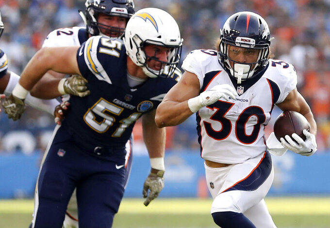 FILE - In this Nov. 18, 2018, file photo, Denver Broncos running back Phillip Lindsay (30) runs with the ball during an NFL football game against the Los Angeles Chargers in Carson, Calif. Broncos rookie running back Phillip Lindsay will attend the Pro Bowl this month as a social media correspondent on the NFL's dime. Lindsay became the first undrafted offensive player to earn a Pro Bowl selection. But a wrist injury at Oakland on Christmas Eve threatened to prevent him from attending the all-star game in Orlando, Florida, this month. (AP Photo/Peter Joneleit, File)