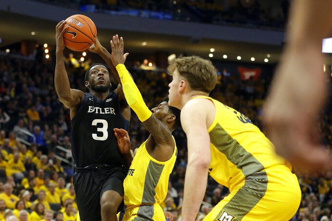 Butler's Kamar Baldwin (3) drives the basket against Marquette defenders during the second half of an NCAA college basketball game Sunday, Feb. 9, 2020, in Milwaukee. (AP Photo/Aaron Gash)