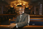 "CORRECTS NAME OF CHURCH TO FIRST INSTITUTIONAL BAPTIST CHURCH FROM INSTITUTIONAL BAPTIST CHURCH In this Tuesday, July 30, 2019 photo,  Civil Rights leader Rev. Dr. Warren H. Stewart Sr. sits in the sanctuary of his church, the First Institutional Baptist Church, in Phoenix. Phoenix's past segregation has been in focus after this summer's national outrage over a videotaped encounter of police pointing guns and cursing at a black family. ""That has long been a reality for African Americans, to not be treated fairly by the police,"" said Stewart. ""Segregation has been outlawed, but the remnants of systemic racism and discrimination remain.""  (AP Photo/Ross D. Franklin)"