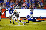 Missouri running back Larry Rountree III (34) tries to get past Florida linebacker Khris Bogle (8) and defensive back Kaiir Elam (5) during the first half of an NCAA college football game Saturday, Oct. 31, 2020, in Gainesville, Fla. (AP Photo/John Raoux)